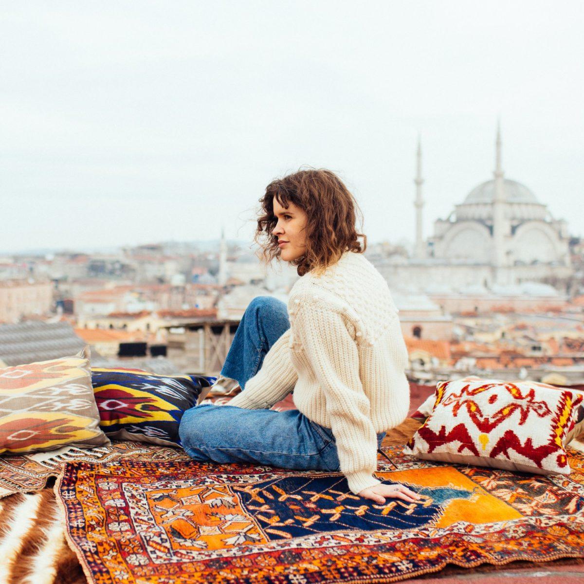 sitting on a rug