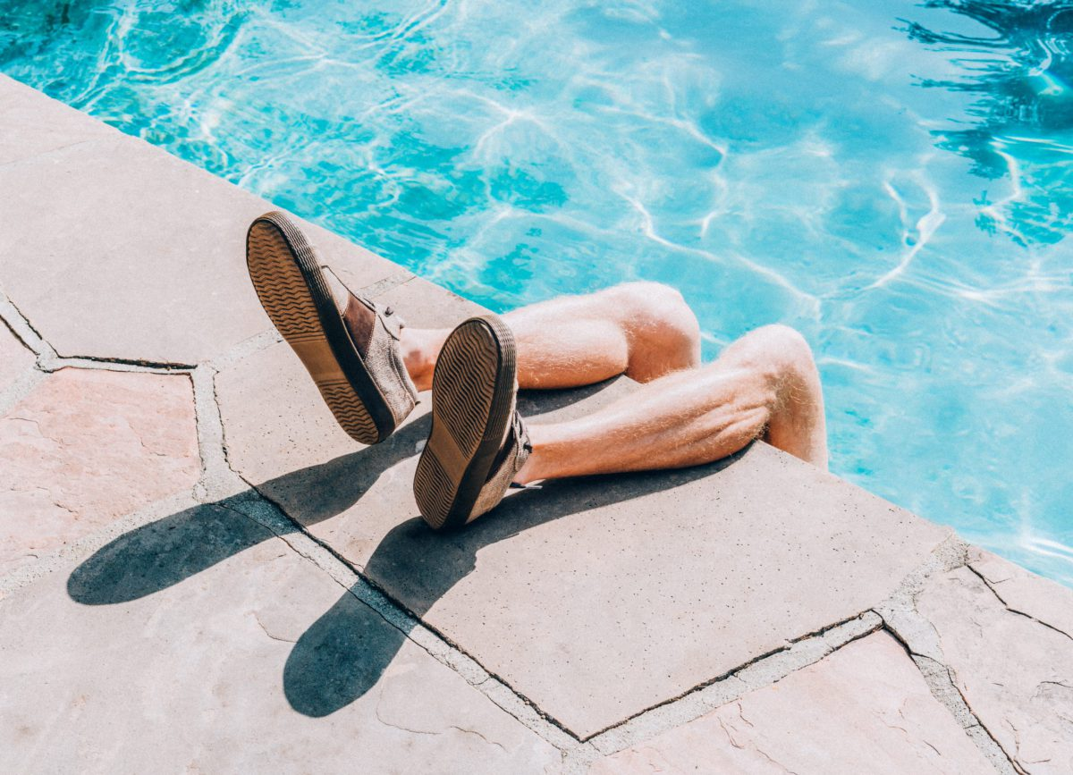 legs hanging on the edge of the pool