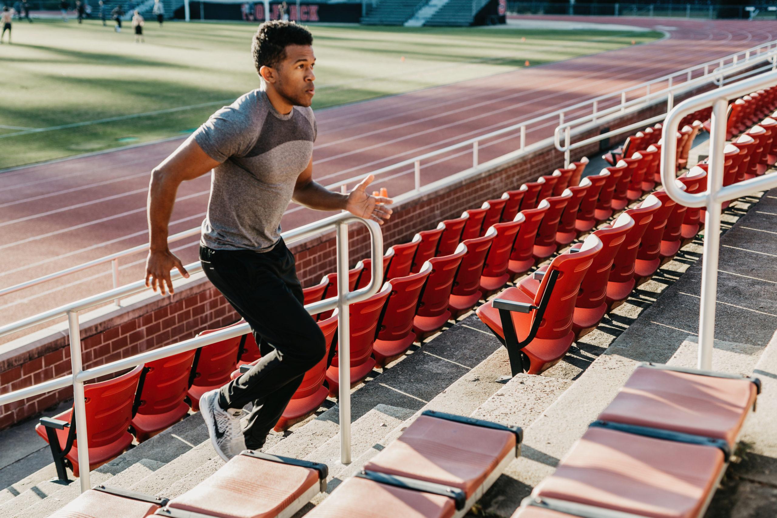 male running up stadium steps
