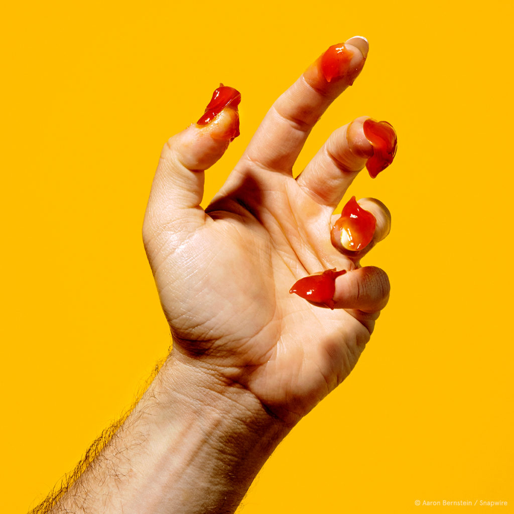 hand portrait with ketchup for nails