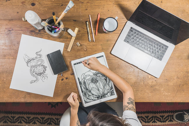 female drawing on iPad