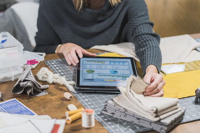 female working on ipad