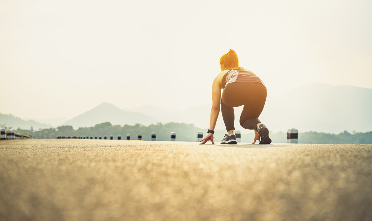 girl getting ready to sprint on track