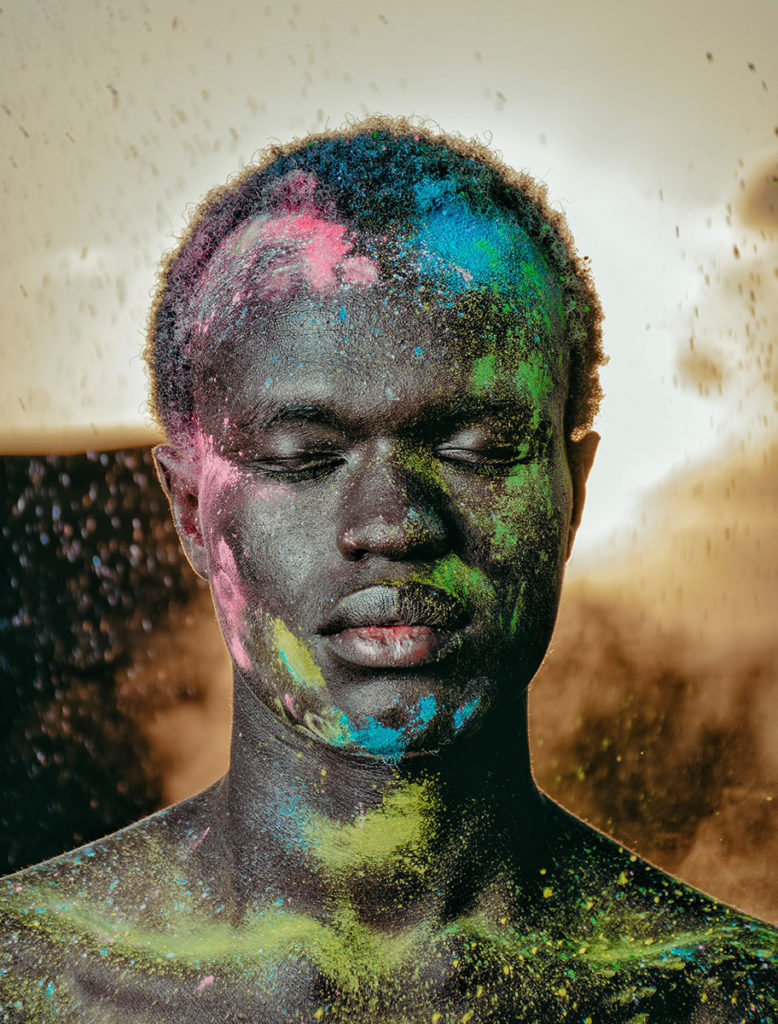 portrait guy covered in colored dust