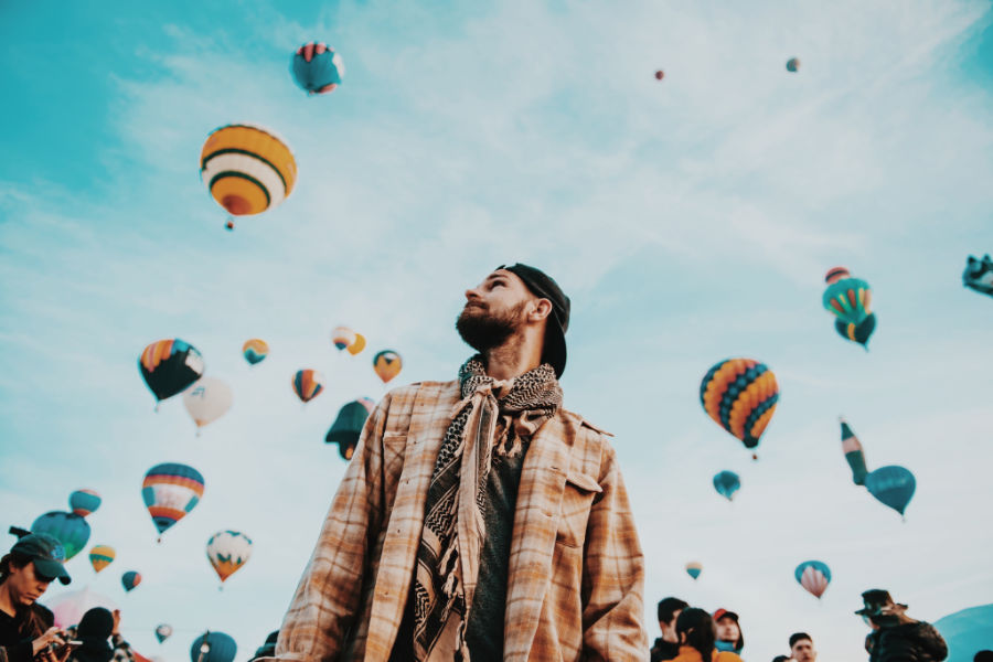 man at hot air balloon festival