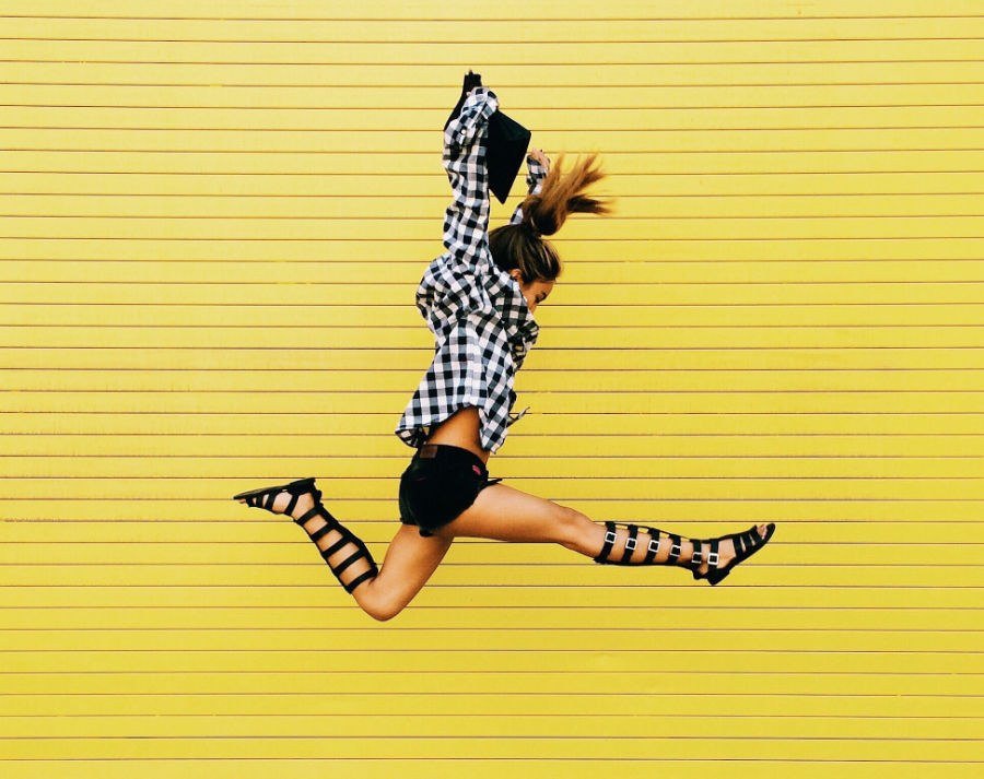 female jumping in air during visual content production