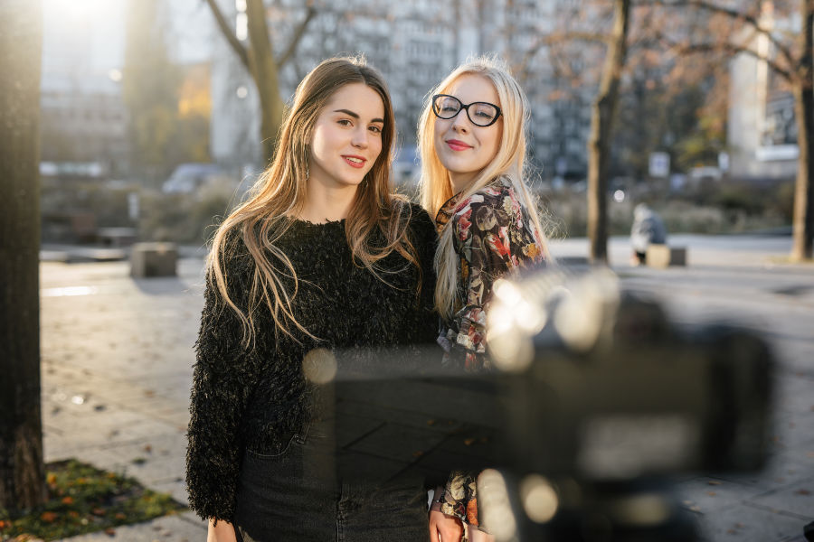 two young females in front of video camera