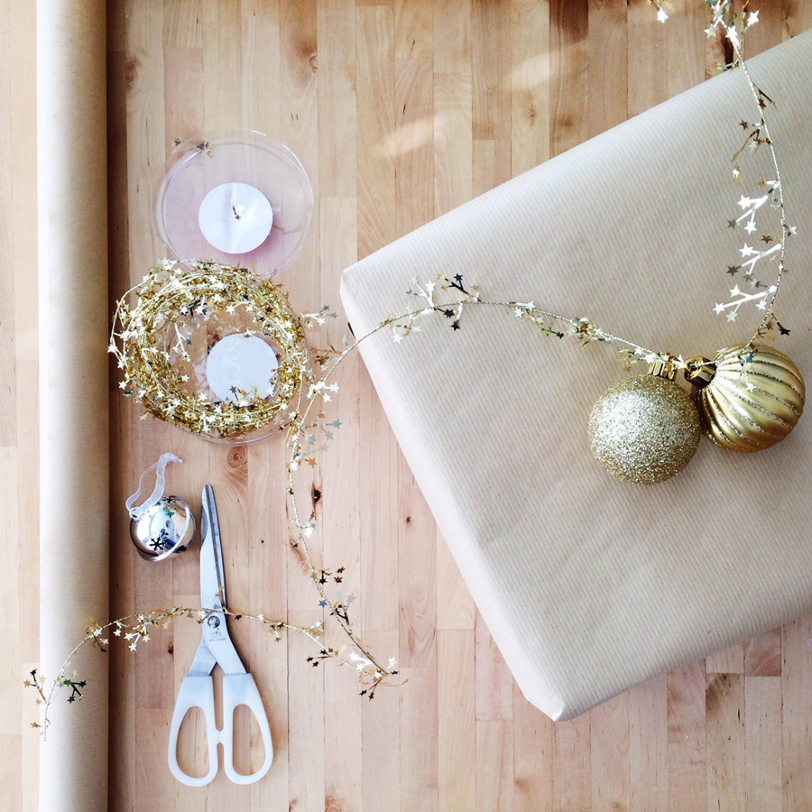 gold tinsel with holiday ornaments