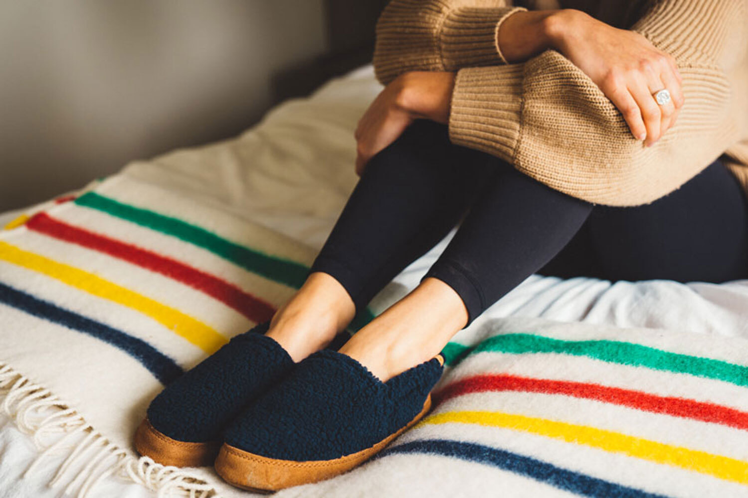 Totes black slippers indoor lifestyle photography