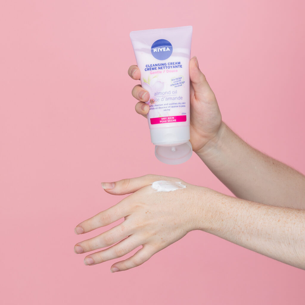 nivea lotion and persons hand