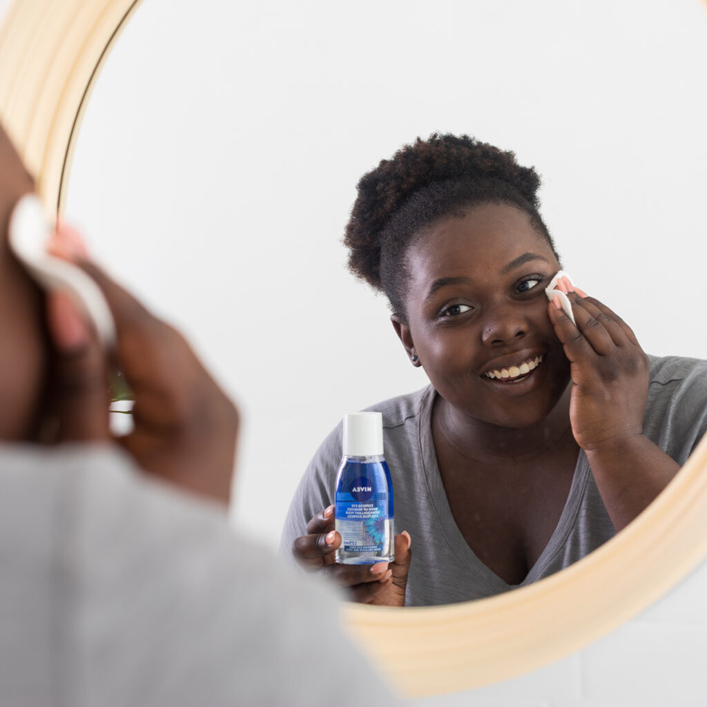 nivea essentials person cleaning face