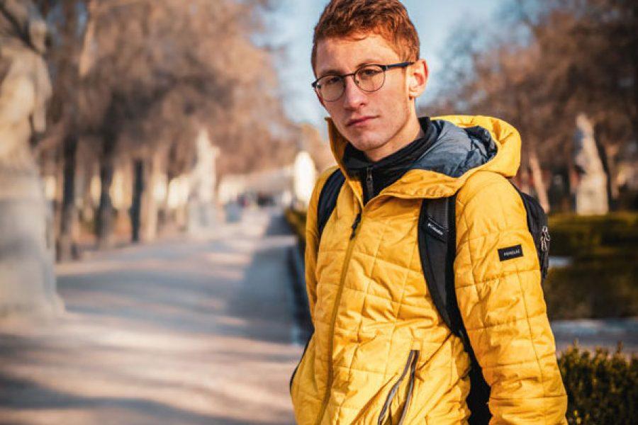 Headshot of man outdoors staring at camera