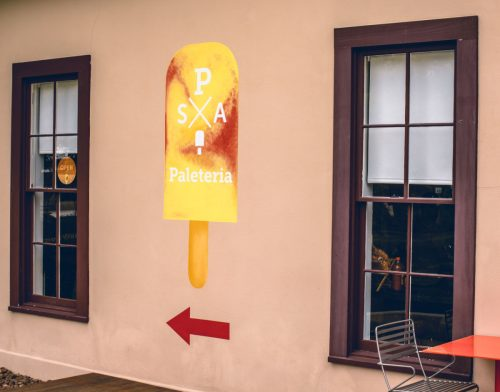 Paleteria popsicle sign painted on local building
