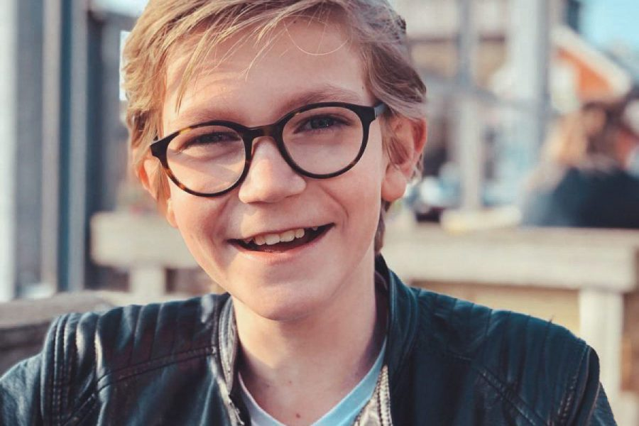 Young man with glasses and a smile