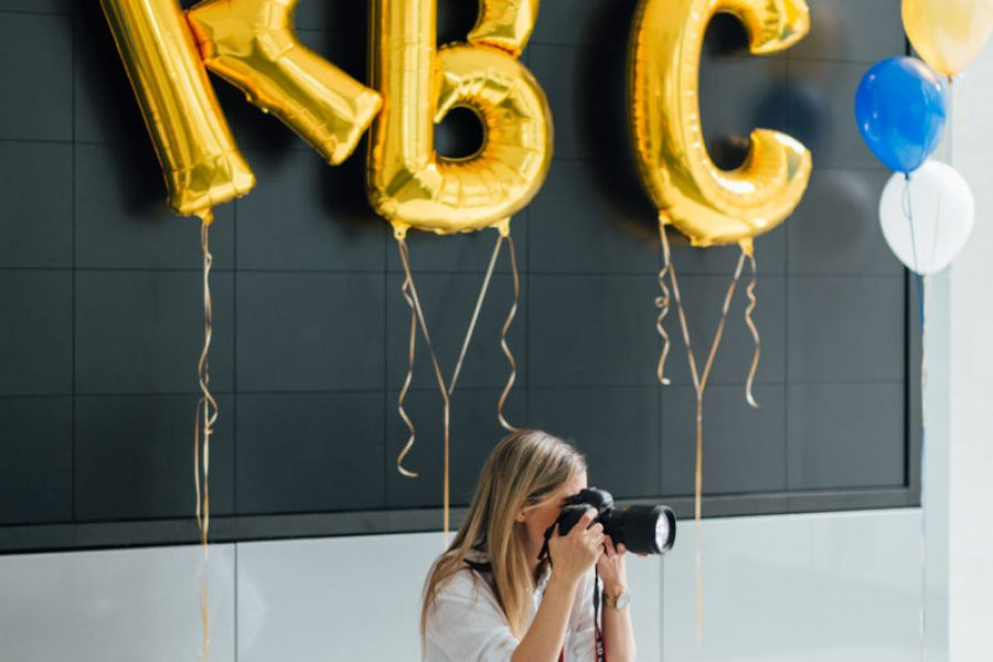 woman with camera and RBC balloons