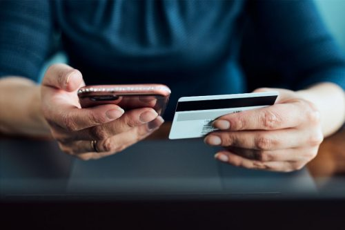 female purchasing online with mobile