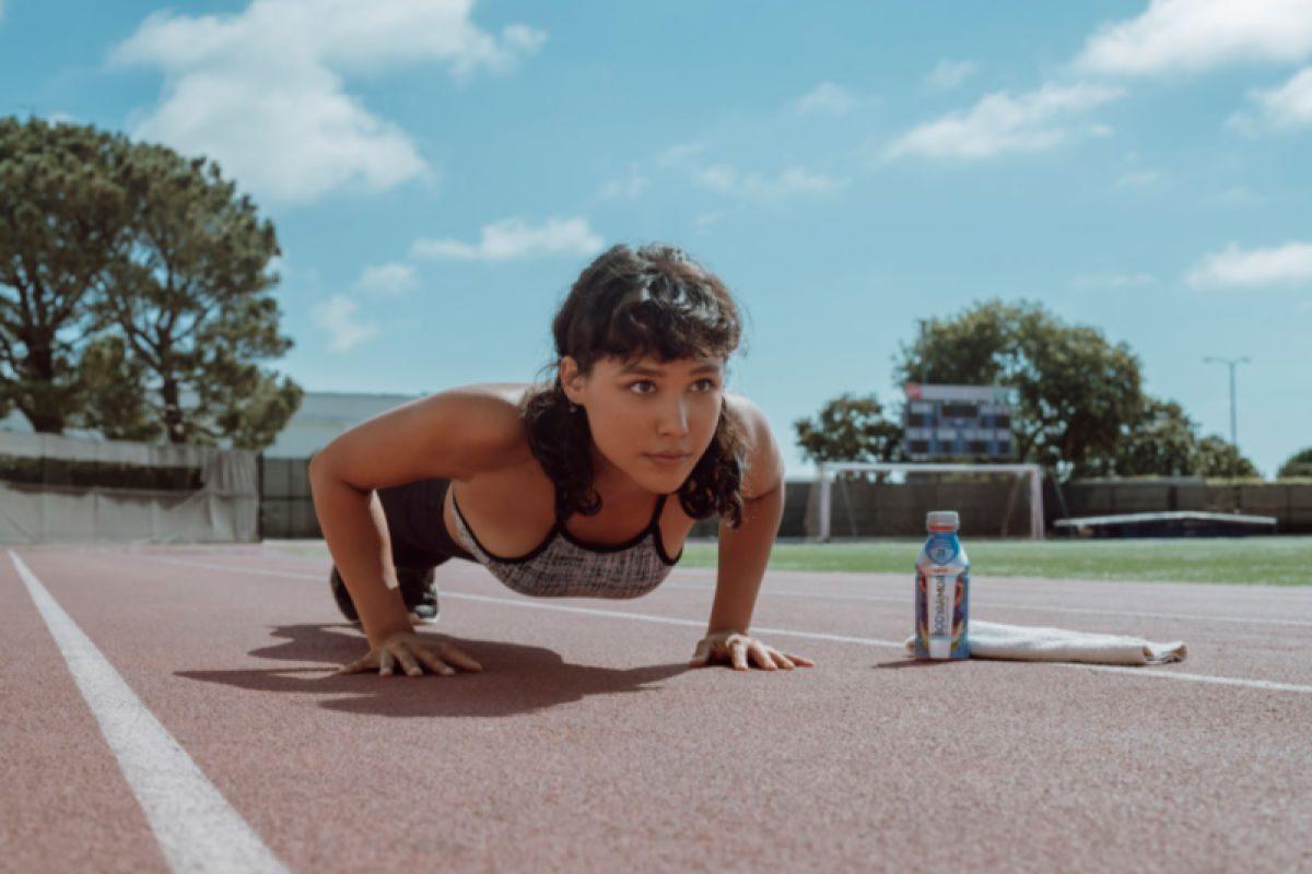 female runner doing pushups